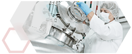 Anasazi Instruments laboratory researcher opening hatch of mixing tank