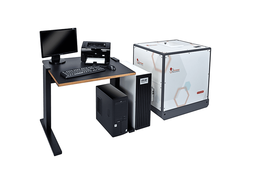 Anasazi Instruments 60 MHz NMR spectrometers near desk with computer equipment