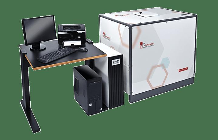 Anasazi Instruments 90 MHz NMR spectrometers near desk with computer equipment