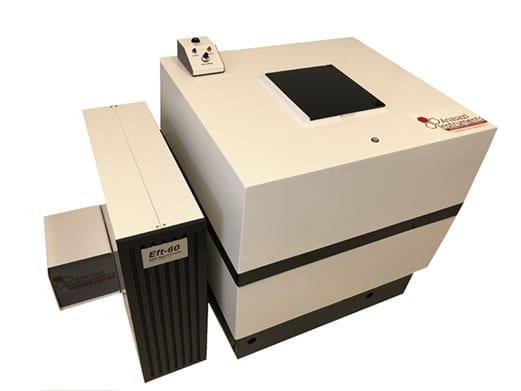 Anasazi Instruments FT NMR spectrometer with EM-360 magnet near computer desk and equipment
